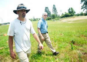 In June 2010, Goshen College Assistant Professor of Biology Ryan Sensenig and Utility Manager and Sustainability Coordinator Glenn Gilbert check the progress of the prairie grasses and flowers.