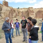 Eric Polingyouma, left, teaches the group about Hopi migration patterns.
