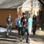 Sunday Mahaja leads the students as they tour the camp.