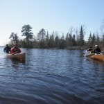 Students practice canoeing across Fall Lake.