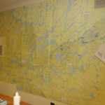 A collection of Boundary Waters maps pieced together on a WW wall.