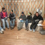 "Students singing hymns in the yurt during our ""farewell"" worship service."