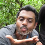 Vasanth handling a large nonvenemous spider during our first hike at Yachana Lodge
