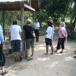 Viewing excavated hole, Killing Fields