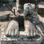 Severed feet at ruins