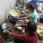 Preparing Cambodian pancake feast