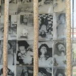 Photos of Tuol Sleng's victims between the bars.