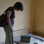 Carina examines the instruments of torture at Tuol Sleng.