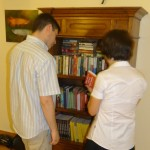 Joel and Carina check out the SST Cambodia library at the Graber Miller home.