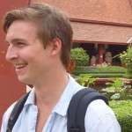 Jake at the National Museum, with boy monks in the background.