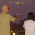 Keith shows Carina some of the landmarks on the Phnom Penh nighttime skyline.