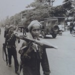 "Photo from April 17, 1975, when Khmer Rouge troops marched down Monivong Boulevard to ""liberate"" Phnom Penh."