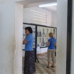 Lauren and Audrey examine photos of Tuol Sleng victims.