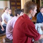 Students listen to the monk at Wat Langka.