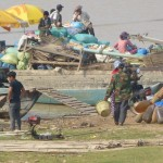 Boats preparing to head out from Prey Veng with their loads on Sunday morning.
