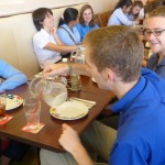 Students enjoyed a wide variety of pizzas for lunch with RUPP students.