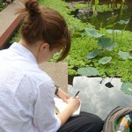 Sara K writes in her journal at the National Museum.