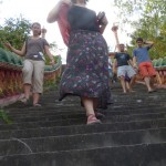 Lauren and others come down a steep stairway at Nokor Phnom