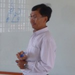 Teacher Chorry teaching Khmer script.