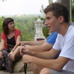 Sarah T, Lauren, Henry and others take a break on the long Nokor Phnom walk.