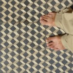 Some of the beautiful ceramic tile (and Keith's feet) at Wat Langka. The tile is from the French Protectorate period in Cambodia's history.