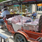 Fresh-cut chicken, anyone? Tuk-tuks are used for hauling food and other goods as well as people.