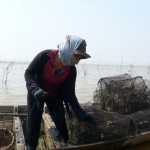 WomenWorkingWithFishingNets