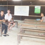 Jake and Ratana wait for their English students at the local church