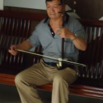 The manager of the guest house where we stayed at Sichuan Normal University playing his erhu (in Sichuan dialect: erfu) and singing at the end of the day.