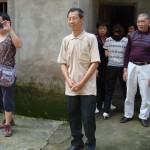 Mr. Duan stands as those gathered sing Happy Birthday in English and Chinese.