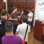 Sam plays a violin at Sichuan University Conservatory.