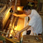 The silk weavers demonstrate their remarkable skills on a traditional silk loom at Chengdu's Silk Brocade Museum. The weaver is creating the pattern upside down, visible to him (and us) via a small floor mirror.