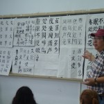 Professor Liu comments on student work, which he had posted in the front of the room.