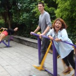 SSTers try out some community exercise equipment in Zigong