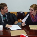 A teaching pair at Langzhong brainstorms ideas for classes after receiving their schedule.