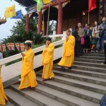 Devoted laity leave Jinguang Temple following the service devoted to the renunciation day of Bodhisattva Guanyin.