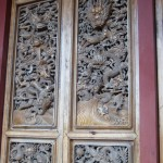 One of many intricately carved doors at the Huaguang Temple (Buddhist)