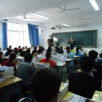 Bryan and Ellen teaching an English class in Yilong. There are 80 students in this classroom.