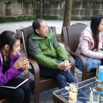 Tea by the river in Gunag'an. Angeliky, Mr. Huang, and Lee