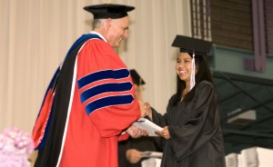 Student and President Brenneman at commencement