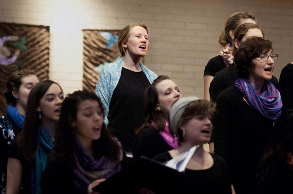 Kate Friesen, a senior English major from Archbold, Ohio, sings with the Goshen College Women's World Music Choir during a recent performance. (Photo by Brian Yoder Schlabach)