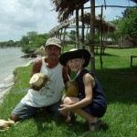 Mr. Orlando, a guide in Awas, shows Conrad how to chop a coconut and drink the water out of it.