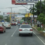 In Managua: lots of billboards, and street peddlers at every stop.
