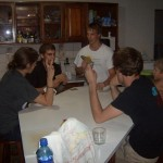 Waiting for each batch to finish baking ... by playing cards.  Austin came over as moral support.