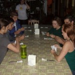 Back at the hotel, playing cards while waiting for dinner.