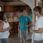 Isaac and Daniel talk with Jen Eberly, one of the SST Nicaragua leaders for 2011, while Connie puts the final touches on almuerzo.