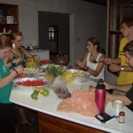 Students preparing fruit salad (left to right: Lisa W, Alisha, Lisa H, Phil, Jacob).