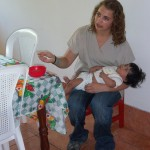 Mandi feeds Alba at the Nutritional Center