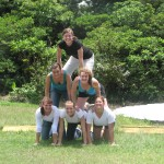 some of the girls making a pyramid while waiting for other groups