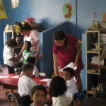Jennifer handing out hand-drawn Nicaraguan flags for the students to color